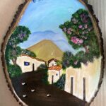 Casas con calle y de fondo volcán